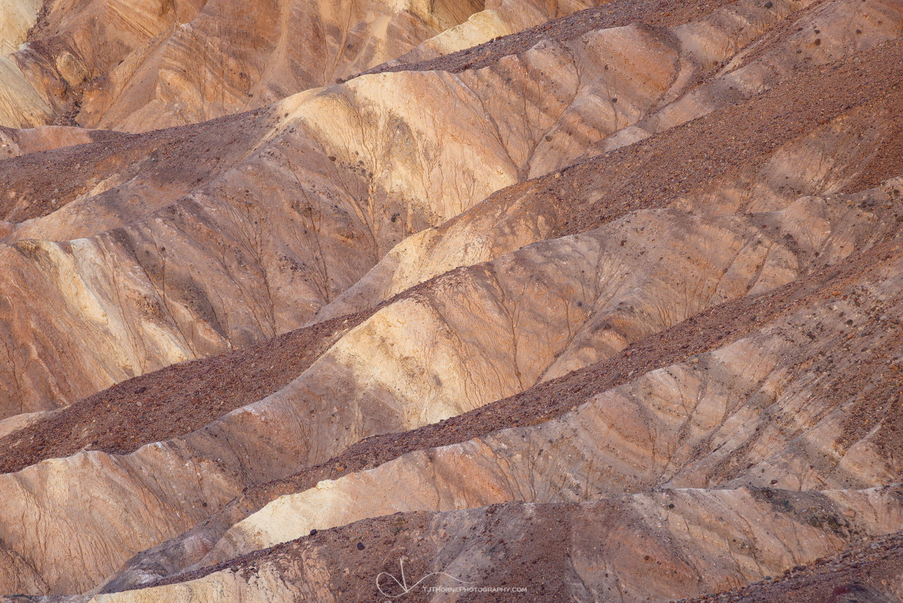 FINE ART LIMITED EDITION OF 100 An abstract of variegated badlands in Death Valley National Park.