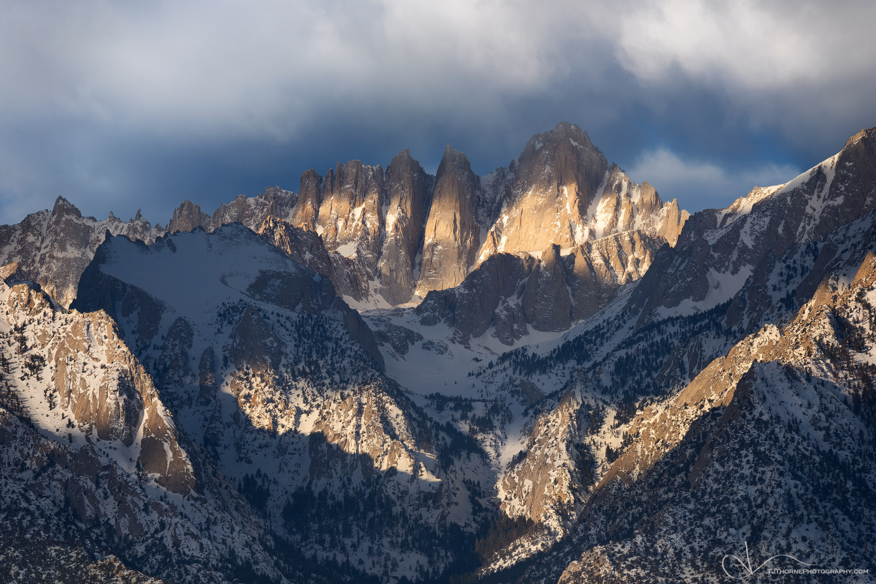 FINE ART LIMITED EDITION OF 100 Late morning light filtered through parting clouds strikes the face of Mt. Whitney in the Eastern...